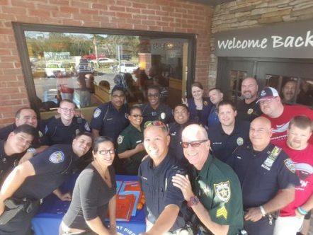 Local law enforcement officials from the St. Lucie County Sheriff's Office and the Fort Pierce Police Department